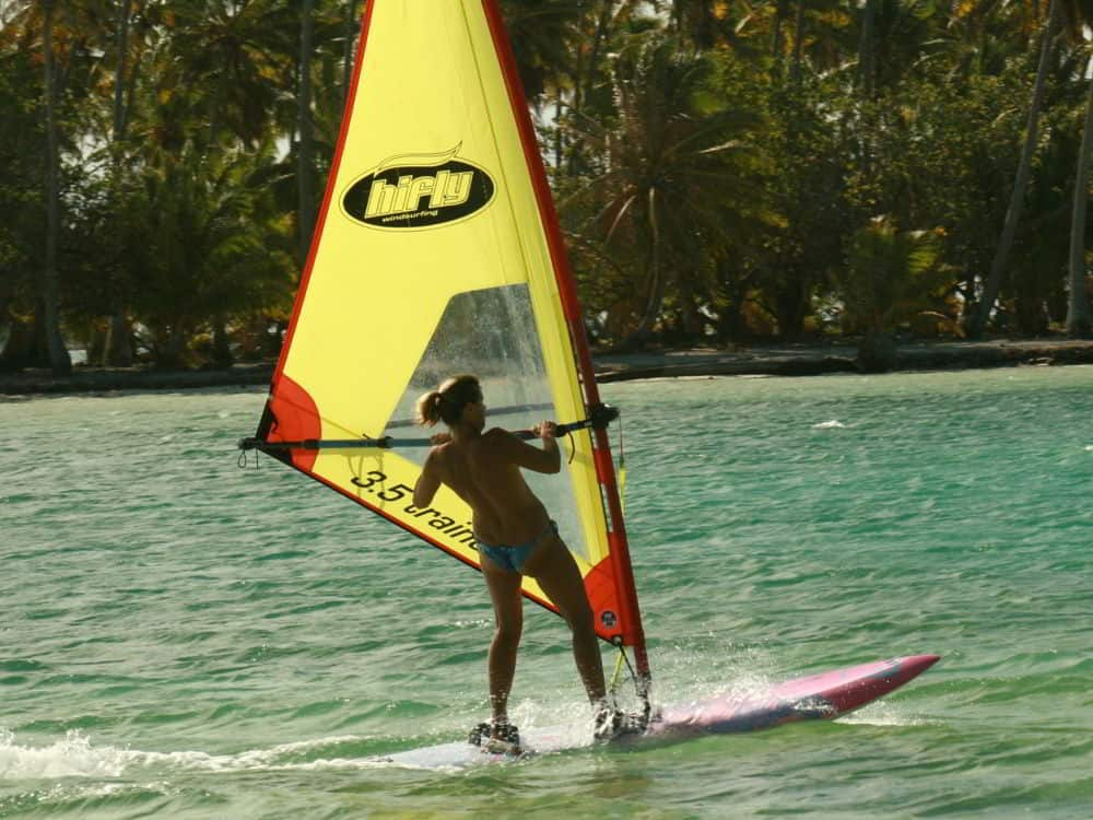 windsurfing around your private island in Tahiti