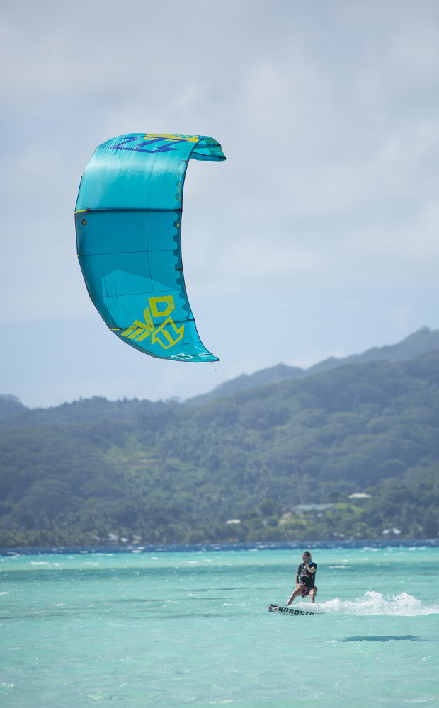 kitesurfing in the shallows around private Tahiti island