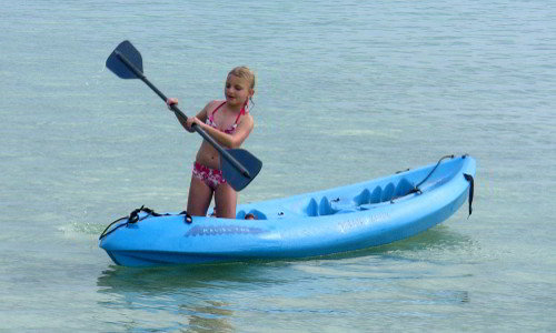 learn to kayak in the shallow waters around Motu Moie