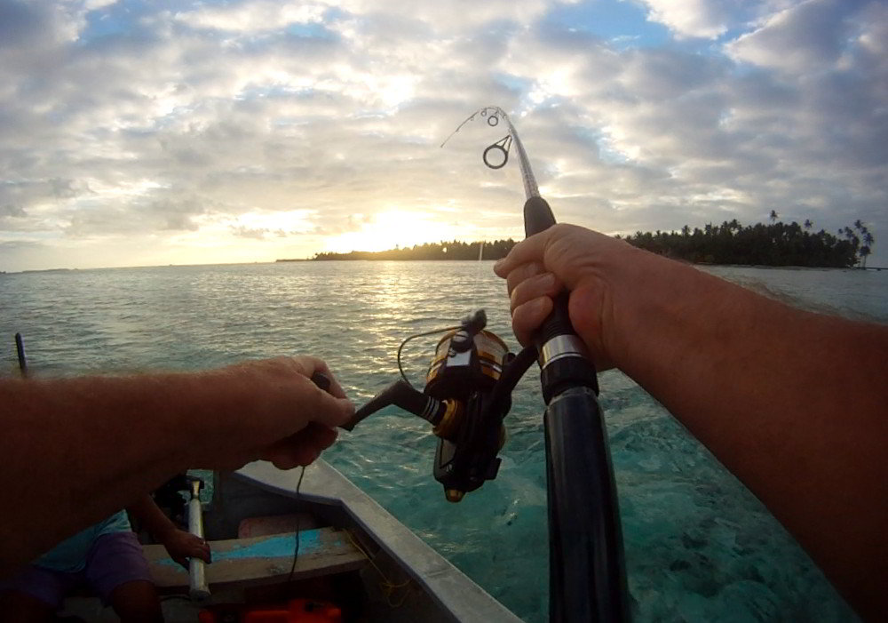 Fishing from boat in the Tahaa lagoon near Motu Moie