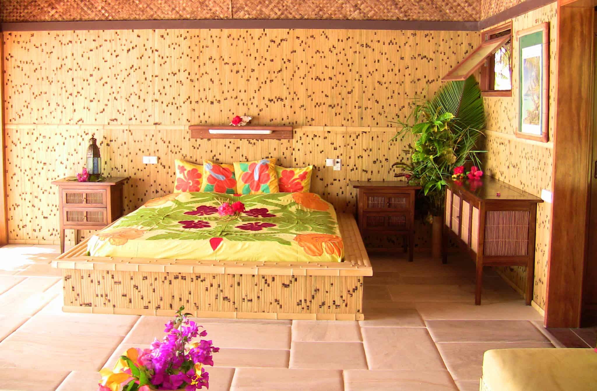 guest bed in bungalow on private Tahiti motu