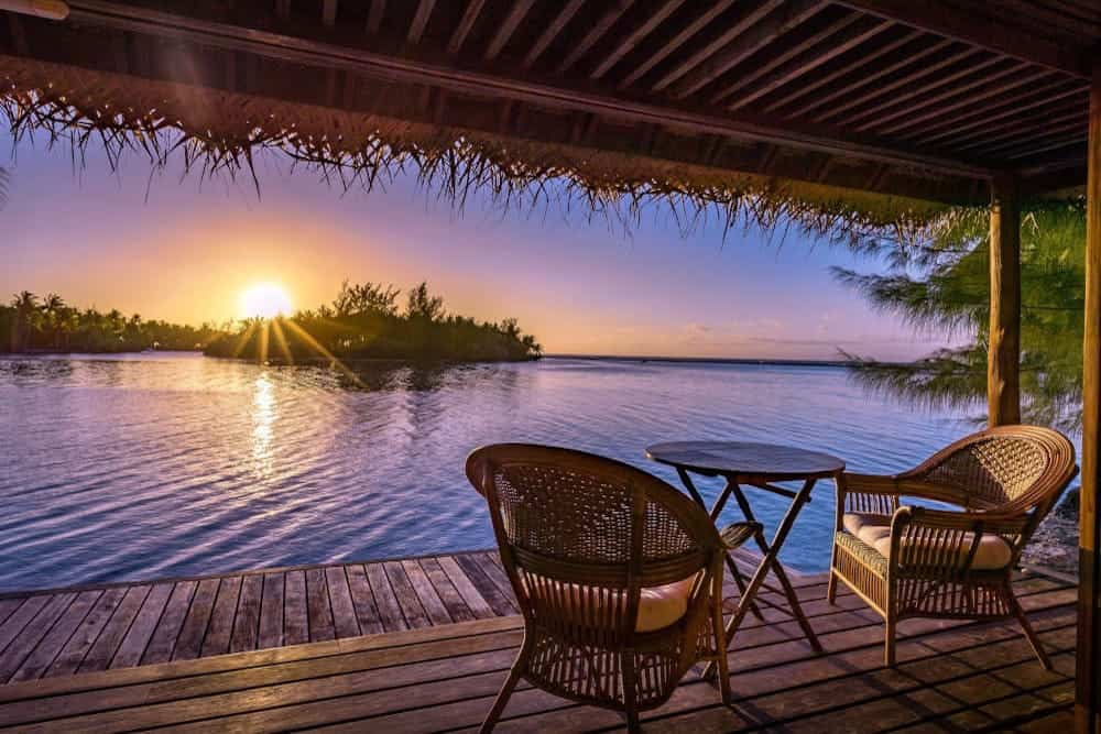 Sunset view from private island bungalow in Tahiti