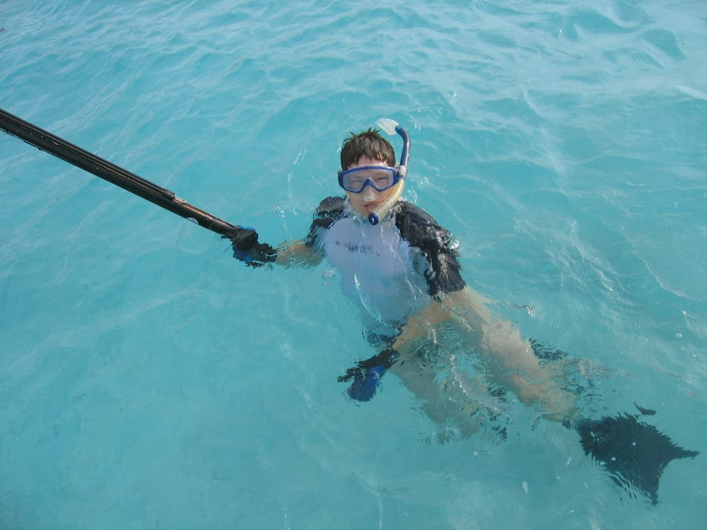spear fishing in the crystal clear waters near Motu Moie