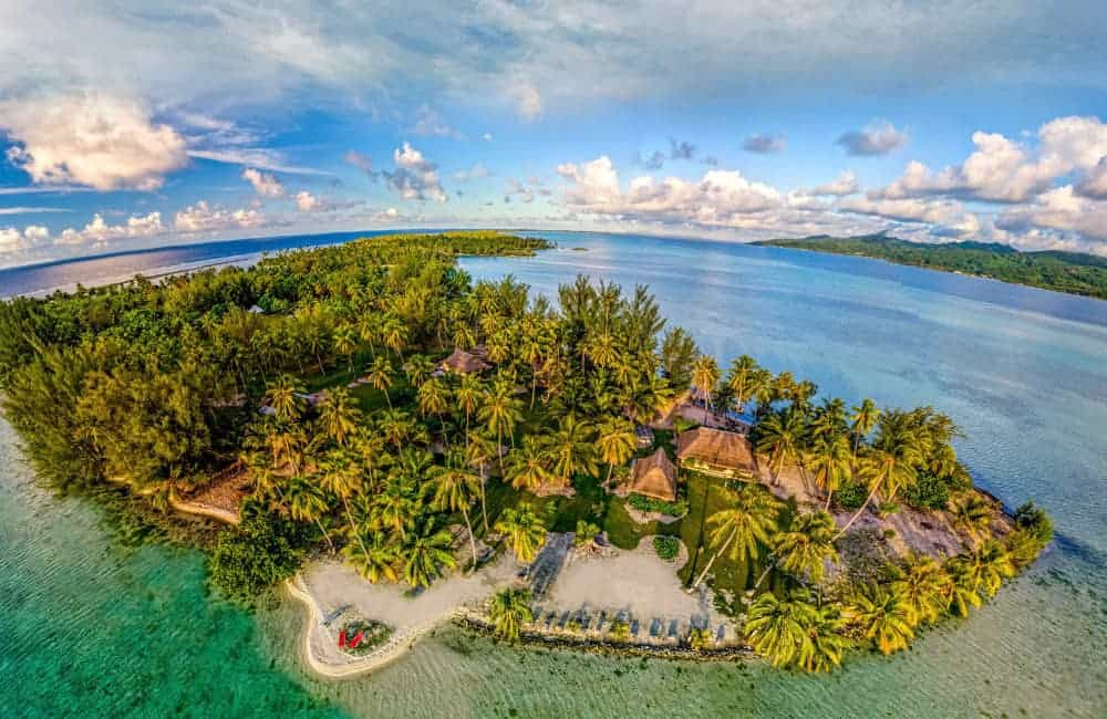 Aerial closeup view of Motu Moie, private Tahiti island for sale, within the lagoon near Taha'a
