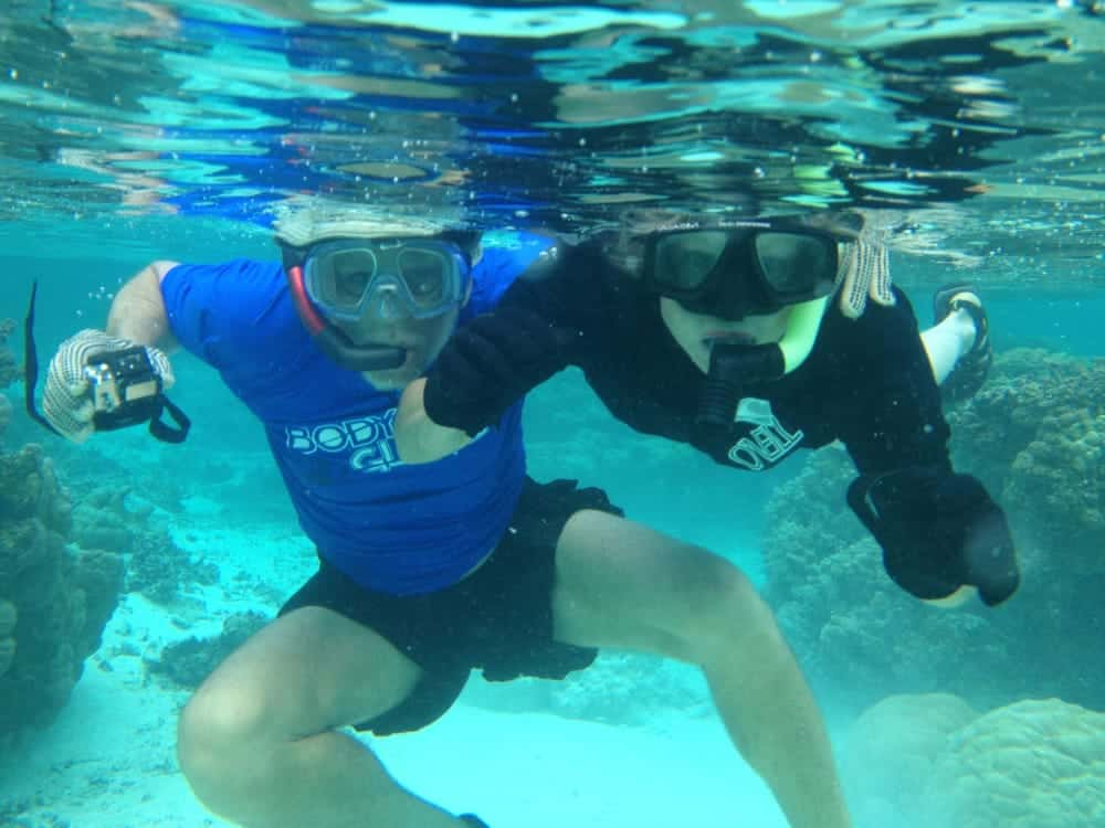snorkeling with GoPro in lagoon surrounding Motu Moie, Tahiti island for sale