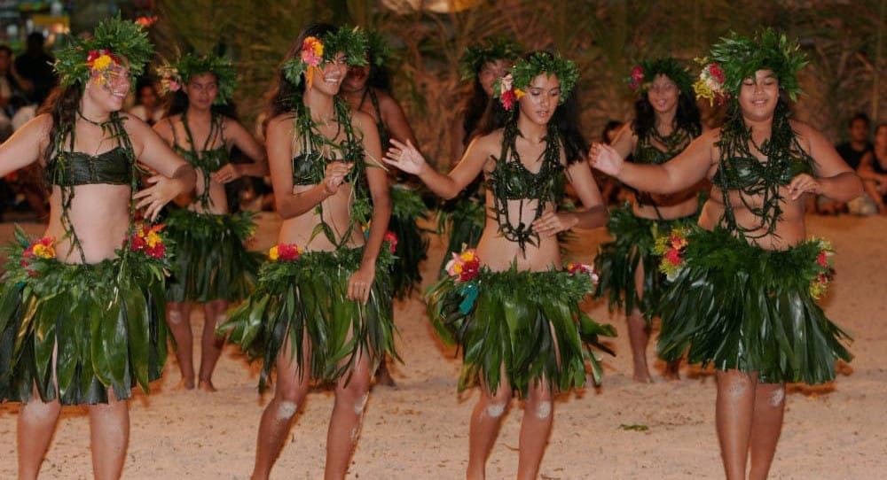 local Tahitian girls dance at month long Heiva dance festival each year in Tahiti